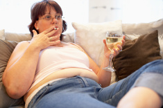 stock-photo-19766896-overweight-woman-relaxing-on-sofa