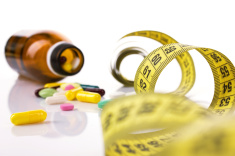 stock-photo-39453016-diet-concept-with-pills-and-centimeter