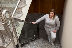 stock-photo-54080256-fatigued-woman-upstairs